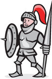 Knight Shield Holding Lance Cartoon. Illustration of knight in full armor with lance and shield facing front standing on isolated white background done in Stock Photography