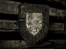 Knight shield on wall. Black and white. Old knight shield hangs on the wall in a castle. Black Stock Image