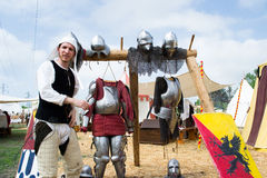Knight shows the parts of medieval armor. Crevalcore,Italy-May 4,2013:actors dressed in medieval clothes show how people lived once in an medieval encampment of Royalty Free Stock Photo
