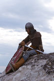 Knight sitting on a rock Royalty Free Stock Image