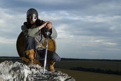 Knight sitting on a rock Stock Photography