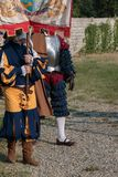 Knight and  Squire with City Standard during Parade in Historica. L Event Reconstruction Royalty Free Stock Photos