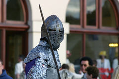 Knight with sword. Armor knight with sword. People on backgorund Royalty Free Stock Photo