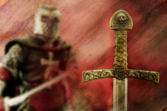Knight and sword background. Medieval sword with knight figure background Royalty Free Stock Photo