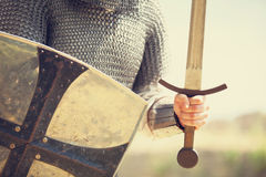 Knight with sword. Photo in vintage style Stock Photo