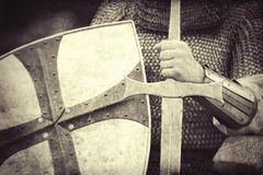 Knight with sword and shield. Photo in vintage style Stock Image