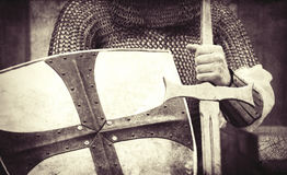 Knight with sword and shield. Photo in vintage style Royalty Free Stock Photography
