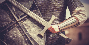 Knight with sword and shield. Photo in vintage style stock photography