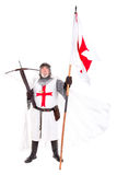 Knight Templar. Posing with crossbow and flag isolated in white Royalty Free Stock Image