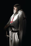Knight Templar. Posing with sword in a dark background Stock Photo