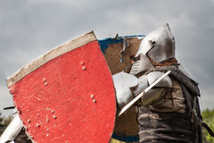 Knight tournament. The knights in the congregations are fighting in the ring. Public event in the city. Soldiers in armor of the Middle Ages Royalty Free Stock Images