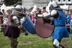 Knight tournament. The knights in the congregations are fighting in the ring. Public event in the city. Soldiers in armor of the Middle Ages Royalty Free Stock Image