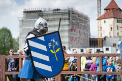 Knight tournament. The knights in the congregations are fighting in the ring. Public event in the city. Soldiers in armor of the Middle Ages Stock Photo