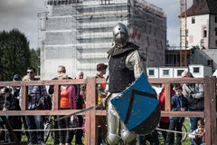 Knight tournament. The knights in the congregations are fighting in the ring. Public event in the city. Soldiers in armor of the Middle Ages Stock Photos