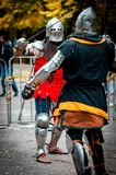 Knight tournament - the struggle of the titans. Roar ... the sound of metal ... the fight ... This is the reality in the modern world at the knight tournament Royalty Free Stock Photos