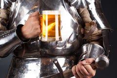 Knight wearing armor Stock Photo