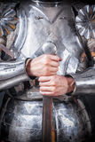 Knight wearing armor. And holding two-handed sword Stock Photo