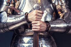 Knight wearing armor. And holding two-handed sword Royalty Free Stock Photo