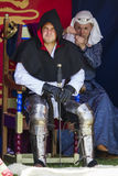 Knight and woman sitting in tent. Medieval Display. Warkworth, Northumberland. England. UK. Royalty Free Stock Images