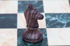 The knight. Wooden chess piece Royalty Free Stock Image