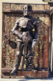 Knightly armor on the door. Suit of armor on the door Royalty Free Stock Photos