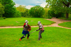 Knightly tournament with swords Stock Images