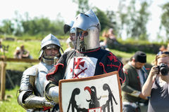 Knights in armor battle Stock Photography