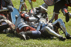 Knights in armor battle Stock Images