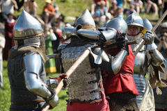 Knights in armor battle Stock Photos