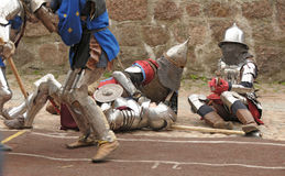 Knights in an armor in the field of fight Stock Photos