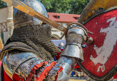 Knights in armor fighting with swords Stock Photos