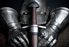 Knights armor with helmet, chain mail, gloves. Picture of a knights armor with helmet, chain mail, gloves and sword Royalty Free Stock Photo