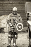 Knights in armor at the historic festival photos in sepia. Shuvalovka, Russia Royalty Free Stock Photo