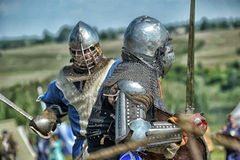 Knights in armor with shields Royalty Free Stock Images