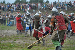 Knights in armor with shields Stock Photos
