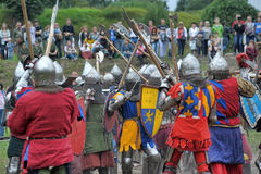 Knights in armor with shields Stock Image
