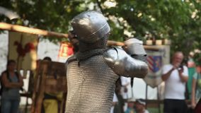 Knights in armor with steel swords at sword fighting stock video footage