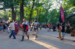 Knights in Armor. Two performers in plate mail armor strut through the crowd entertaining onlookers at the Bristol Renaissance Fair in Wisconsin Royalty Free Stock Photography