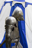 Knights armour 1007. A knights armour in front of a tent in blue and white Stock Photos