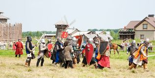 Knights battle. SUZDAL, RUSSIA - JULY 10: knight festival Age-old Suzdal in the old town Suzdal with amateur actors in historical costumes while knight fight on Stock Photography