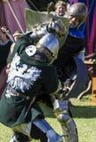 Knights in battle. Medieval Display. Warkworth, Northumberland. England. UK. Royalty Free Stock Photo