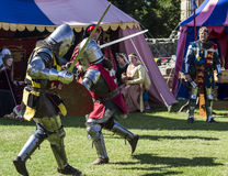 Knights in battle. Medieval Display. Warkworth, Northumberland. England. UK. Stock Photo