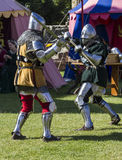 Knights in battle. Medieval Display. Warkworth, Northumberland. England. UK. Royalty Free Stock Photography