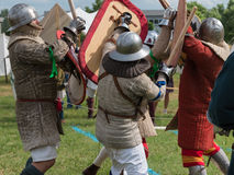 Knights in Battle with Silver Helmets and Armors. Medieval Event Reconstruction Royalty Free Stock Image