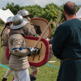 Knights in Battle with Silver Helmets and Armors Royalty Free Stock Photo