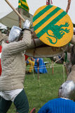 Knights in Battle with Silver Helmets and Shields. Medieval Event Reconstruction Royalty Free Stock Photo