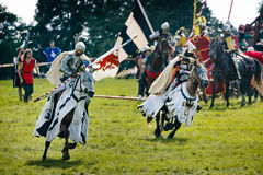 Knights charge on horses stock photo