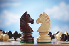 Knights On A Chessboard. Two knights face to face on chessboard Royalty Free Stock Image
