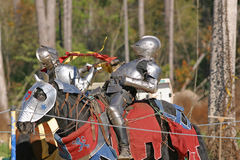 Knights Clash. Two knights clash with lances breaking in a joust Stock Photo