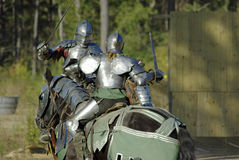 Knights in Combat. Two knights on horseback engaged in a sword fight Royalty Free Stock Images
